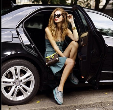 model getting out of fancy car